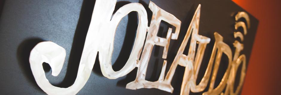http://www.joeaudioproductions.com/wp-content/uploads/2013/10/studioSlider9-JoeAudioAlumLogo2.jpg